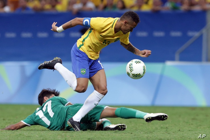 Brazil's Neymar, top, tries control the ball under pressure from Iraq's Alaa Ali during a group A match of the men's Olympic football tournament between Brazil and Iraq at the National Stadium in Brasilia, Brazil, Aug. 7, 2016.