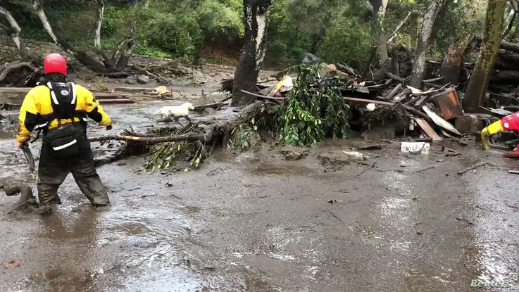 Emergency personnel search through debris and mud flow after a mudslide in Montecito, California, U.S. in this still photo taken from video provided by the Santa Barbara County Fire Department, Jan. 9, 2018.