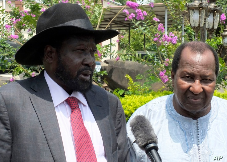 FILE - South Sudan President Salva Kiir, left,  along with former president of Mali, Alpha Oumar Konaré, the AU High Representative for South Sudan, answer questions at the presidential palace in Juba, South Sudan, July 14, 2016.