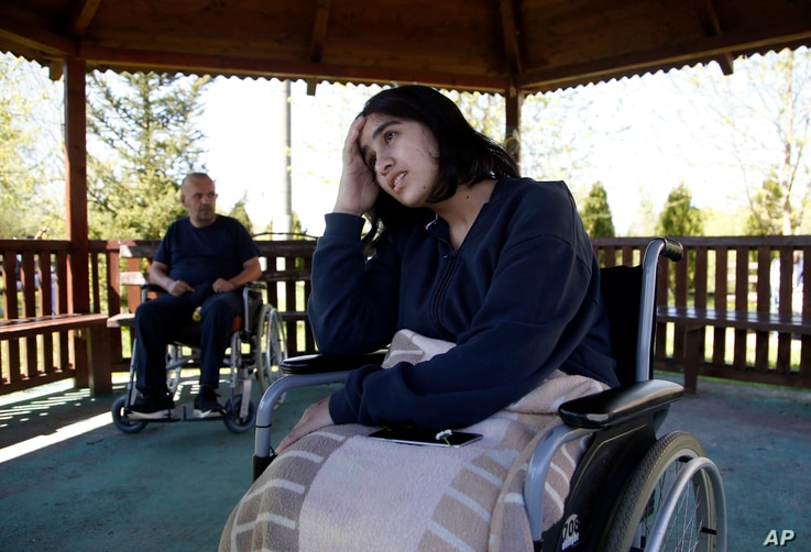 Fatima Bakhshi, a migrant from Afghanistan, uses a wheelchair in a small care home in the village of Doljevac, in southern Serbia, April 10, 2017. The car carrying Bakhshi and other migrants hit a protective barrier and overturned on a highway in sou...