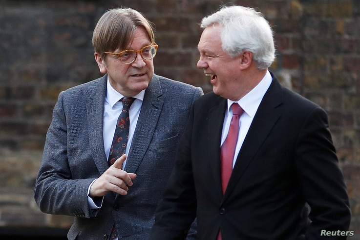 Guy Verhofstadt, the European Union's chief Brexit negotiator, and Britain's Secretary of State for Exiting the European Union David Davis walk up Downing Street in London, March 6, 2018.
