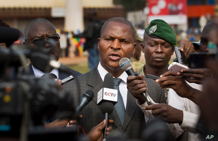 FILE - Faustin-Archange Touadera (C) is seen speaking to the media in downtown Bangui, Central African Republic, Jan. 5, 2013.