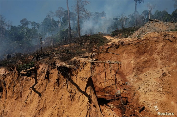 A wildcat gold miner uses high-pressure jets of water to dislodge rock material at a mine, also known as garimpo, at a deforested area of Amazon rainforest near Crepurizao, Brazil, Aug. 2, 2017.