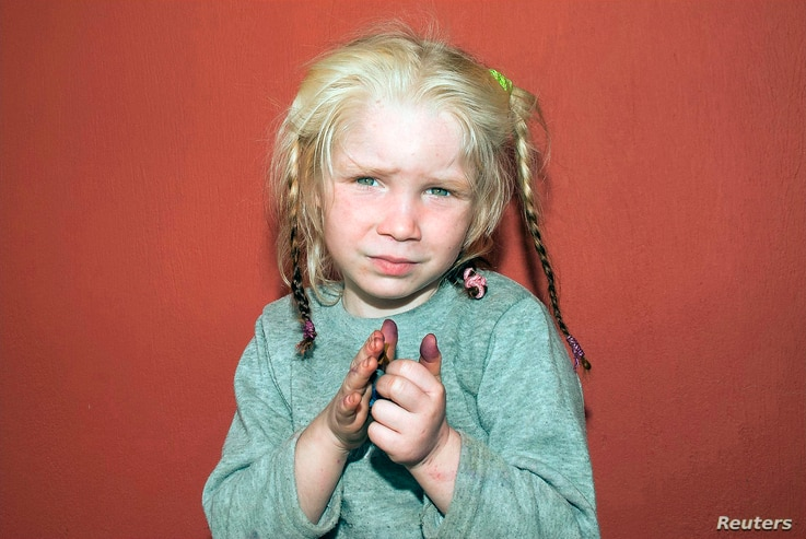 A four-year-old girl, found living with a Roma couple in central Greece, is seen in a handout photo distributed by the Greek police and obtained by Reuters, Oct. 18, 2013.