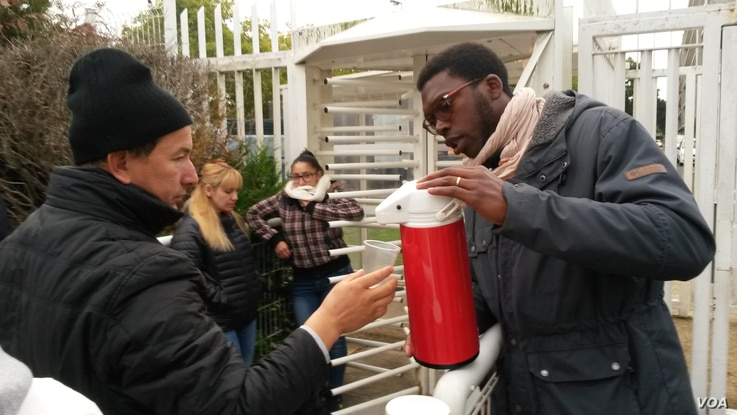 As head of a youth volunteer group in the Essence area outside Paris, Gaetan Ziga is up before dawn at least once a week to serve  coffee to immigrants immigrants lined up to get their legal papers.