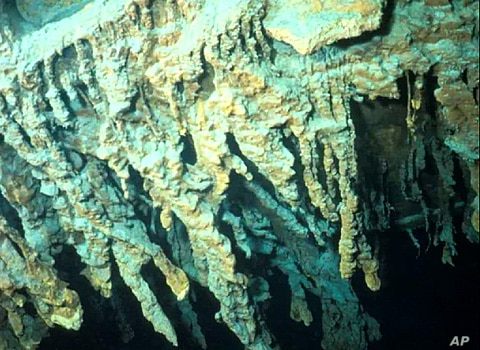 An iron-oxide eating microbe was discovered forming icicle-shaped rusticles on the legendary shipwreck, the Titanic. (RMS Titanic Inc.)