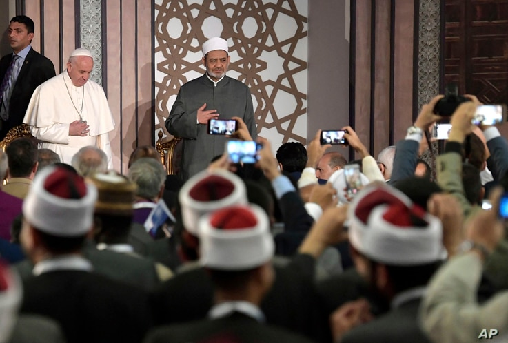 Pope Francis is flanked by Sheikh Dr. Ahmad Al-Tayyeb, Al-Azhar's grand imam, at Al-Azhar University, in Cairo, Egypt, April 28, 2017.