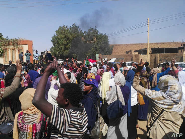 Sudanese protesters chant slogans during an anti-government demonstration in Khartoum's twin city of Omdurman on March 10, 2019.