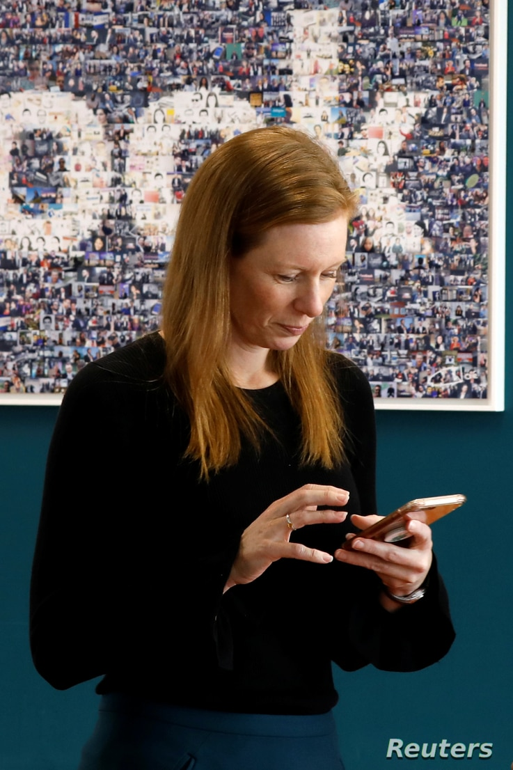 FILE - Monika Bickert, Facebook's head of global policy management checks her mobile phone before attending a content summit at France's Facebook headquarters in Paris, France, May 15, 2018.
