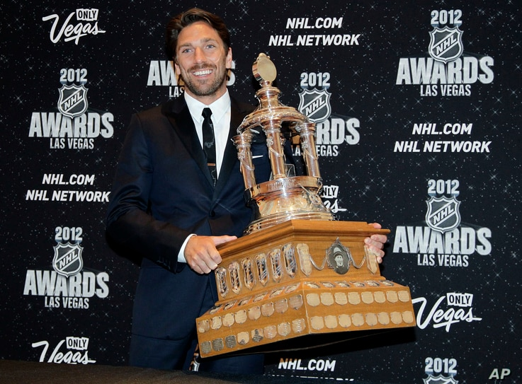 New York Rangers' Henrik Lunqvist poses with the Vezina Trophy after winning the award for the league's best goalie, June 20, 2012, in Las Vegas.