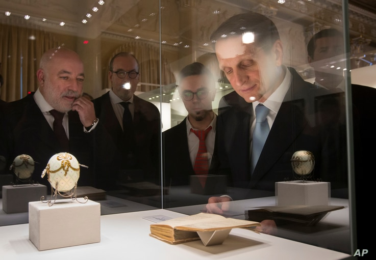 FILE - Sergei Naryshkin, the Chairman of the State Duma and the Chairman of the Board of Trustees of the Faberge Museum, right, and Russian businessman Viktor Vekselberg, the founder of the Faberge Museum, left, examine unique items from the personal...