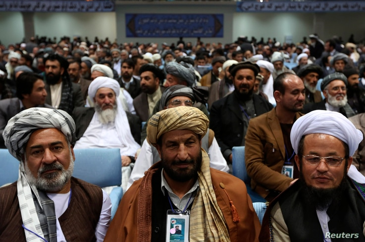 Members of the Loya Jirga, grand council, attend during the last day of the Loya Jirga, in Kabul, Nov. 24, 2013.