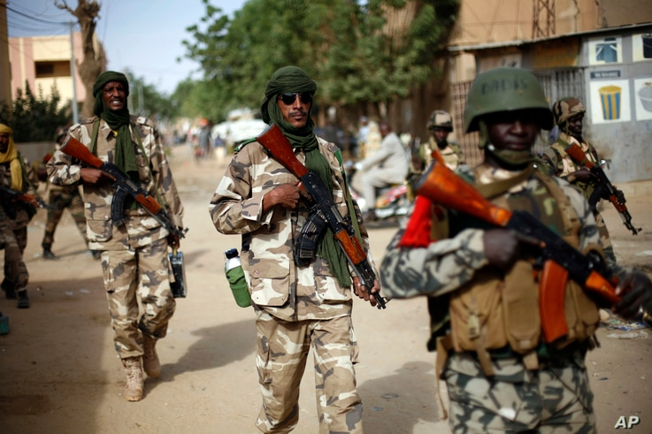 Chadian soldiers patrol the streets of Gao, northern Mali, January 29, 2013.