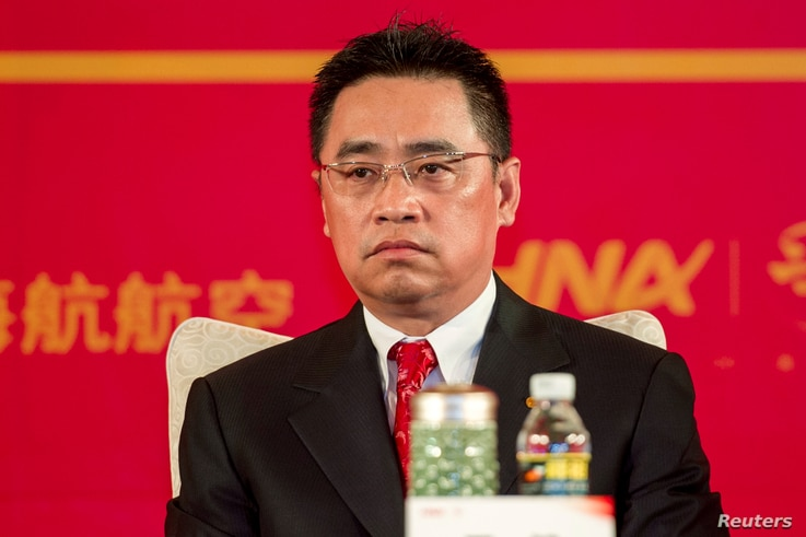 FILE - Wang Jian, of HNA Group, attends a meeting marking the 20th anniversary of company's founding in Haikou, Hainan province, China, April 28, 2013.