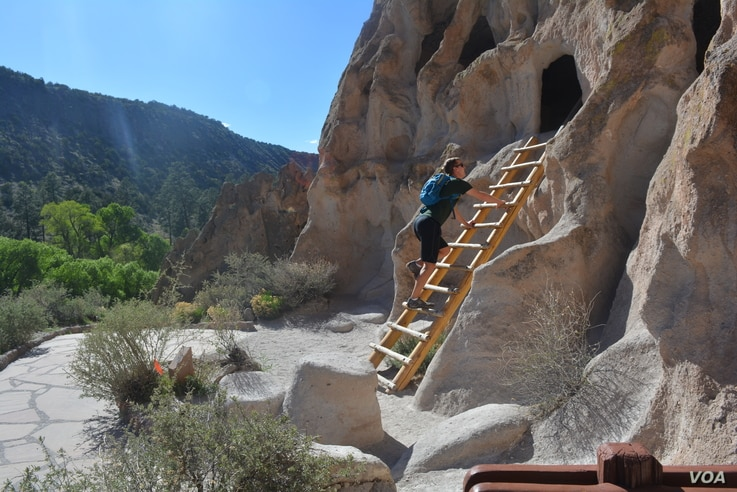 Mikah Meyer explores one of several thousand ancestral Pueblo dwellings that have been carved out within the sheer-walled canyons at Bandelier National Monument.
