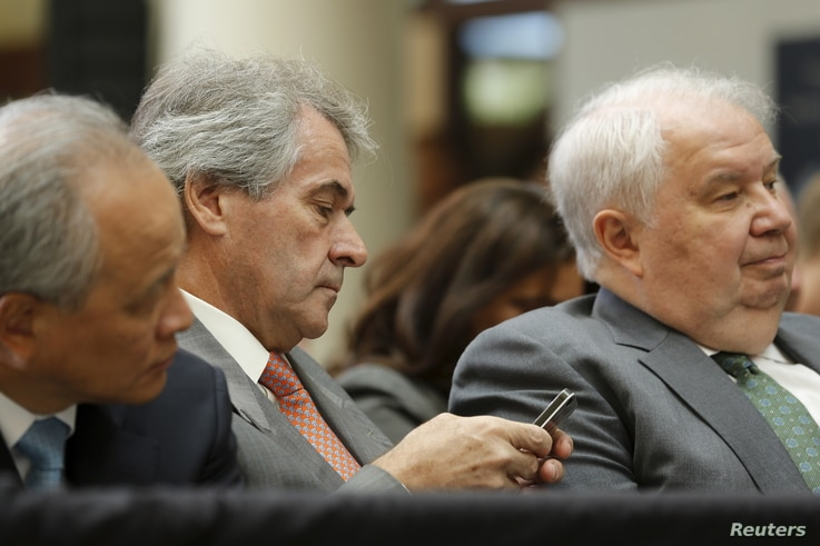 Russia's Ambassador Sergey Kislyak from right, U.K. Ambassador Peter Westmacott  and China's Ambassador Cui Tiankai  wait for U.S. President Barack Obama to deliver remarks on a nuclear deal with Iran at American University, Aug. 5, 2015.
