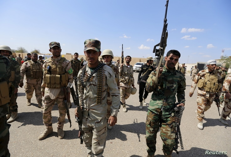 Iran-backed forces allied with Iraqi forces in Ouja, on the southern outskirts of Tikrit, March 26, 2015. The U.S. conditioned its entry into Iraq's battle to retake Tikrit from IS on the withdrawal of Shiite militias from the clearing operation.