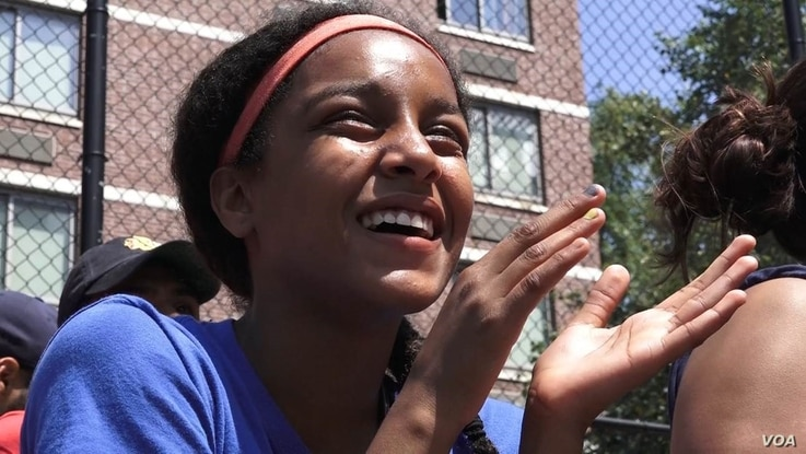 Taina Figueroa, a rising eighth-grader and star Harlem RBI player, watches the 2016 summer championship game, in New York, Aug. 12, 2016.
