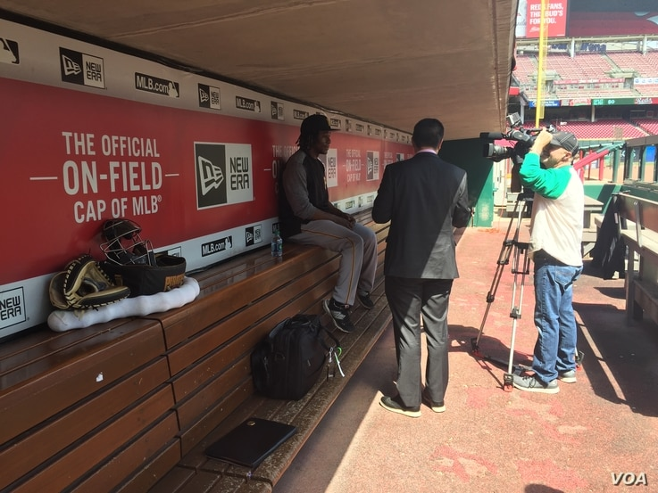 Gift Ngoepe, 27, of the Pittsburgh Pirates talks with the media in the visitors dugout of the Cincinnati Reds ballpark in Cincinnati, Ohio, May 2, 2017.