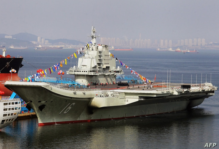 This photo taken on September 24, 2012 shows China's first aircraft carrier, a former Soviet carrier called the Varyag, docked after its handover to the People's Liberation Army (PLA) navy in Dalian, northeast China's Liaoning province.