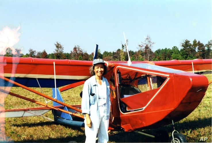 Jeanette Smolinski in front of the ultralight she built, with her father, in her spare time. (Courtesy J. Smolinski)