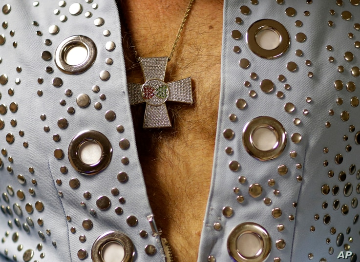 """Jim Westover of Arizona City, Ariz., wears this medallion as he waits backstage before performing at the """"Images of the King: Las Vegas"""" tribute artist contest in Las Vegas, July 15, 2017."""