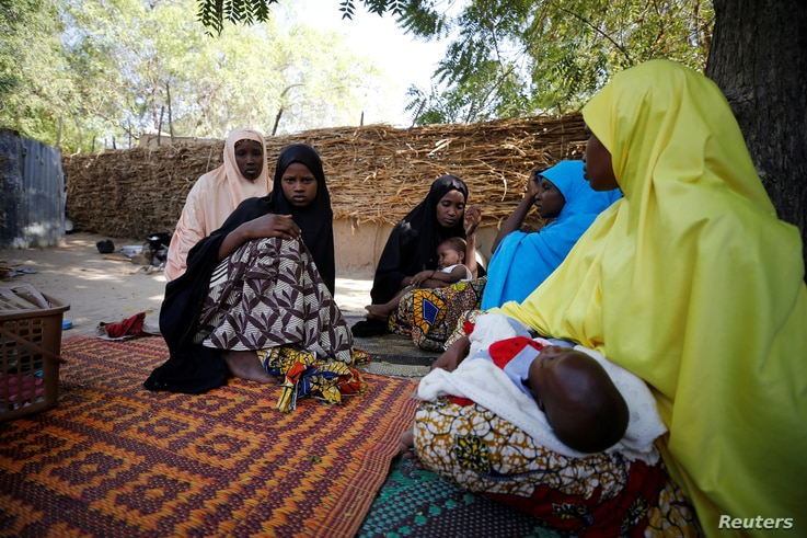 Relatives pay a condolence visit to the mother of one of the abducted Government Girls Science Technical College (GGSTC) Dapchi student in Jumbam village, Yobe State