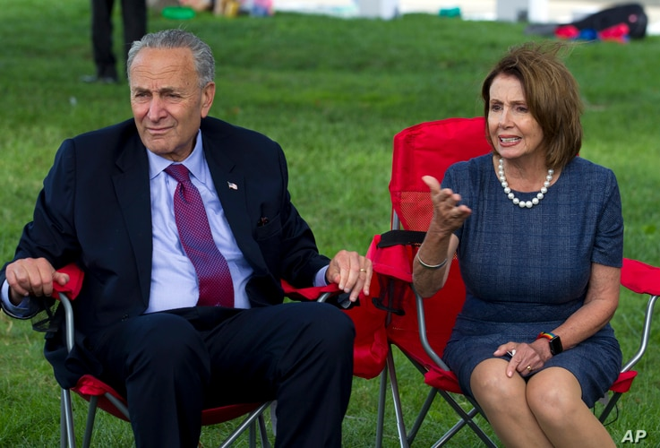 House Minority Leader Nancy Pelosi of California, accompanied by Senate Minority Leader Chuck Schumer of New York, speaks with DREAMERS who are holding a four-day fast on Capitol Hill in Washington, Sept. 7, 2017.