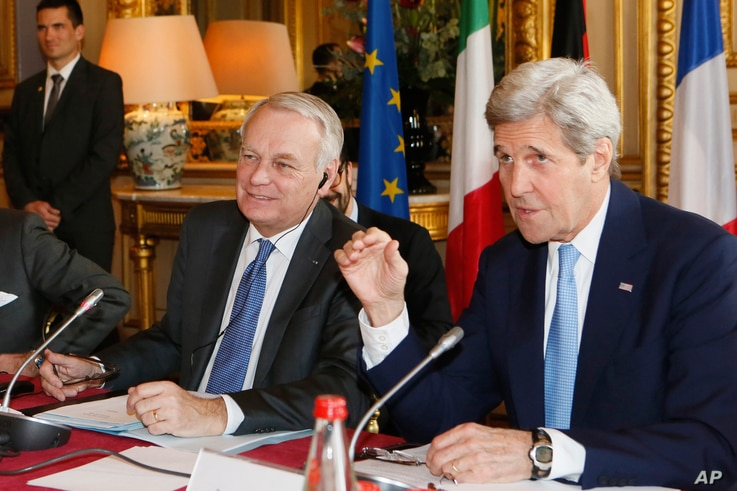 French Foreign Minister Jean Marc Ayrault, left, and U.S. Secretary of State John Kerry attend a meeting at the Quai d'Orsay ministry in Paris, March 13, 2016. Kerry and his counterparts were to discuss Syria, Libya, Yemen and Ukraine, among other fo...