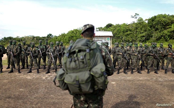 Brazilian Army soldiers are seen at the border with Colombia during a training to show efforts to step up security along borders, in Vila Bittencourt, Amazon State, Brazil, Jan. 18, 2017.