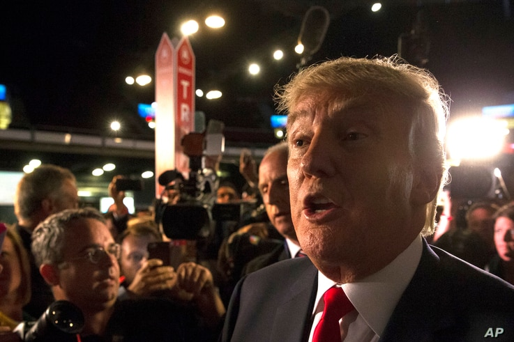 Republican presidential candidate Donald Trump speaks to the media in the spin room after the first Republican presidential debate at the Quicken Loans Arena Thursday, Aug. 6, 2015.