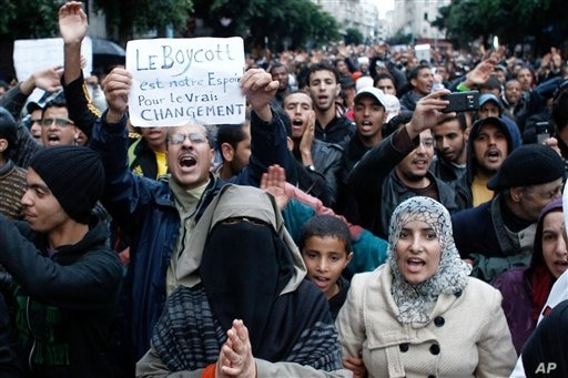 Anti-government protesters shout during a rally organized by the 20th February, the Moroccan Arab Spring movement in Casablanca, Morocco, Sunday, Nov 20, 2011, in a mass popular call to bring more democracy into this North African kingdom. Some thous