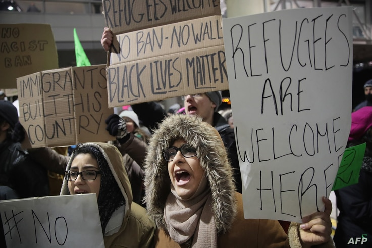 Demonstrators protest President Donald Trump's executive order which imposes a freeze on admitting refugees into the United States and a ban on travel from seven Muslim-majority countries at the international terminal at O'Hare Airport, Jan. 29, 2017...