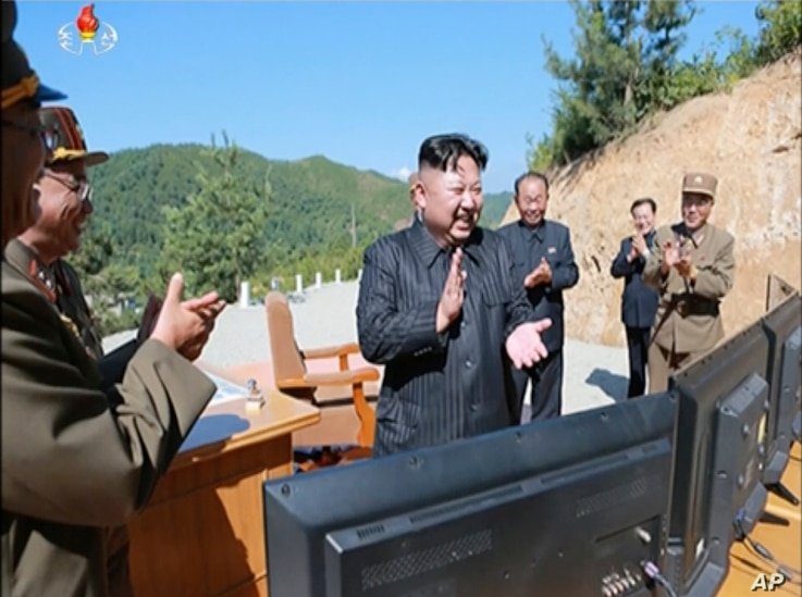 This image made from video of a news bulletin aired by North Korea's KRT July 4, 2017, shows what was said to be North Korea leader Kim Jung Un, center, applauding after the launch of a Hwasong-14 intercontinental ballistic missile, ICBM, in North Ko