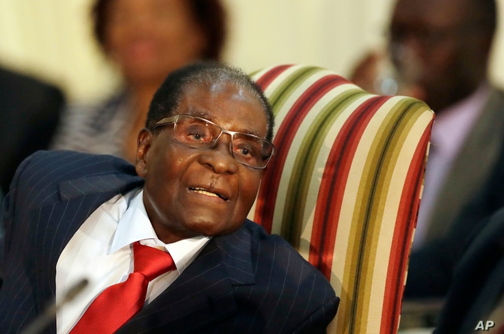 FILE - Zimbabwe's President Robert Mugabe, during his meeting with South African President Jacob Zuma, at the Presidential Guesthouse in Pretoria, South Africa, Oct. 3, 2017.
