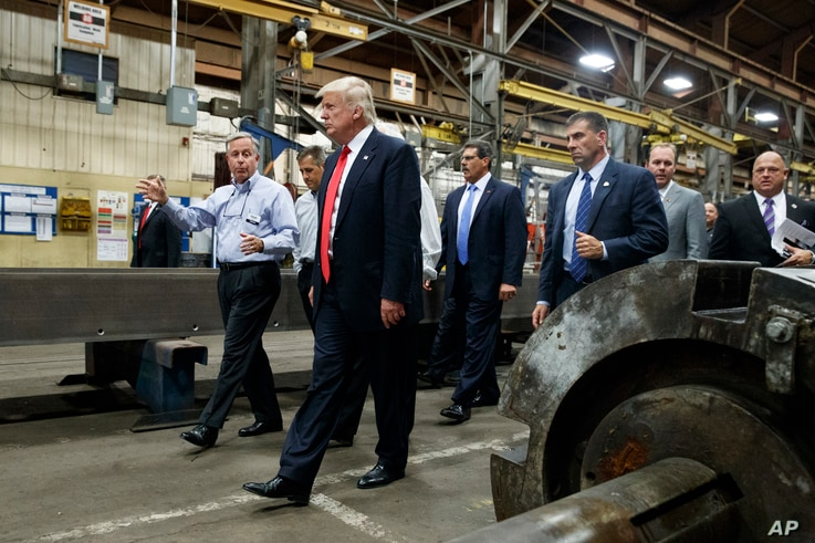 Republican presidential candidate Donald Trump takes a tour of McLanahan Corporation headquarters, a company that manufactures mineral and agricultural equipment, Aug. 12, 2016, in Hollidaysburg, Pa.