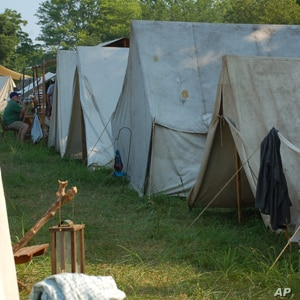 Arriving a day or two before the battle, the re-enactors  set up camp in nearby fields, pitching white canvas tents.