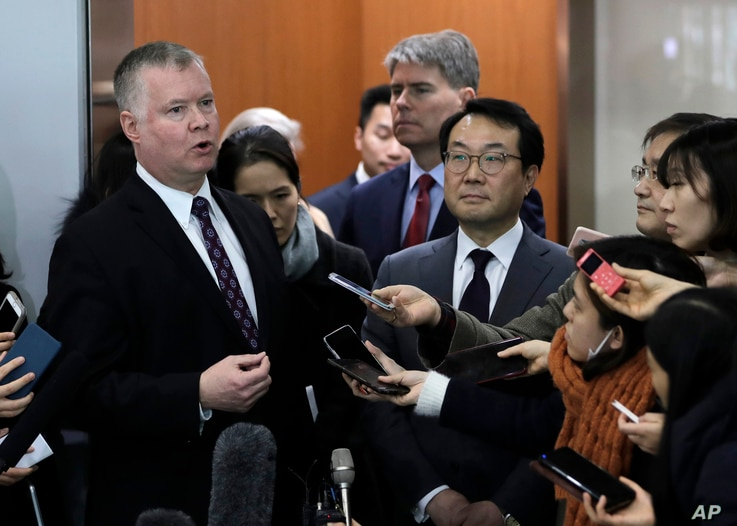 U.S. Special Representative for North Korea Stephen Biegun, left, speaks to the media with South Korea's Special Representative for Korean Peninsula Peace and Security Affairs Lee Do-hoon, center right, at Foreign Ministry in Seoul, South Korea,  Dec...
