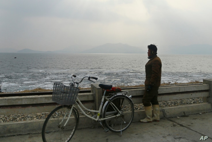 A North Korean man looks out to the sea as he stands on the West Sea Barrage in Nampo, North Korea, Feb. 2, 2019. North Korea's coast is a rich tidal power resource, one European official said.