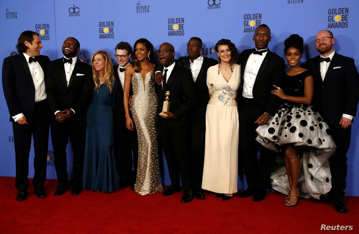 "Cast and crew of ""Moonlight"" poses backstage with their award for Best Motion Picture - Drama at the 74th Annual Golden Globe Awards in Beverly Hills, CA Jan. 8, 2017."