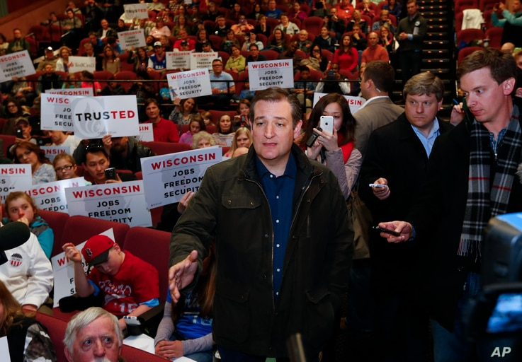 """Republican presidential candidate Sen. Ted Cruz of Texas speaks to the media before watching the movie, """"God's Not Dead 2,"""" in Ashwaubenon, Wis., April 2, 2016."""