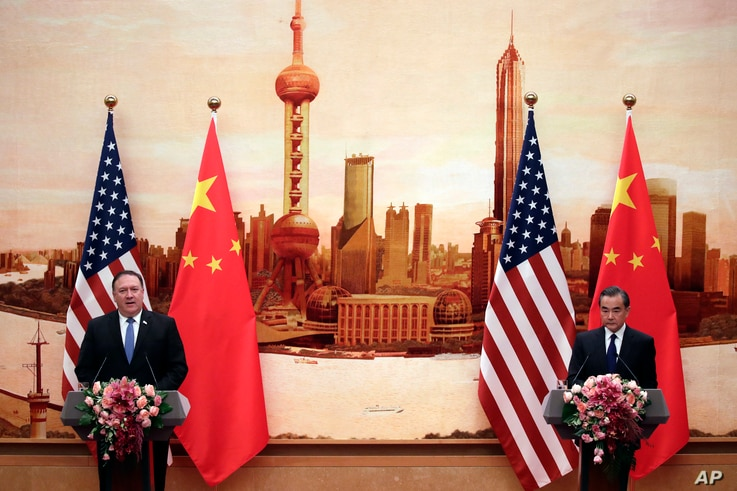 U.S. Secretary of State Mike Pompeo, left, speaks during a joint press conference with Chinese Foreign Minister Wang Yi at the Great Hall of the People in Beijing, June 14, 2018.