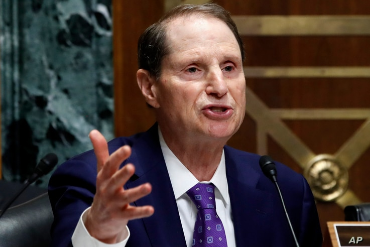 Ranking member of the Senate Finance Committee Sen. Ron Wyden, D-Ore., asks a question of Secretary of Commerce Wilbur Ross during a committee hearing on tariffs, June 20, 201