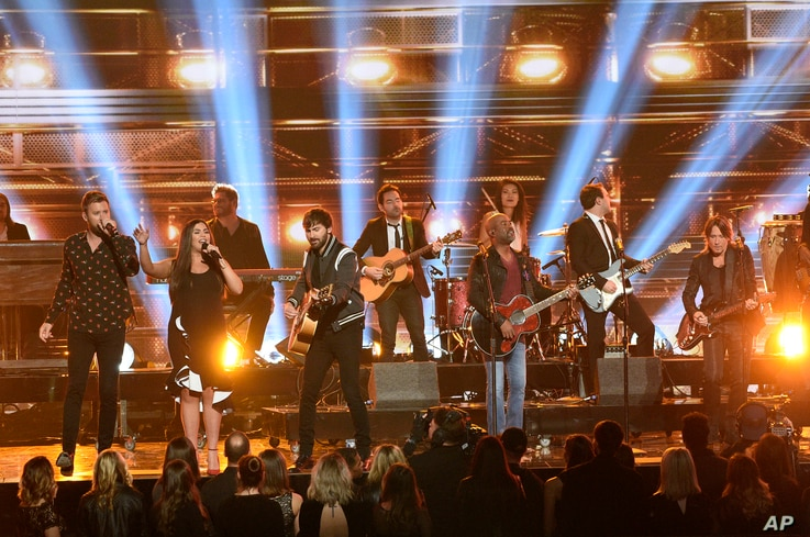 Charles Kelley, from left, Hillary Scott, Dave Haywood, Darius Rucker and Keith Urban perform a medley at the 51st annual CMA Awards at the Bridgestone Arena, Nov. 8, 2017, in Nashville, Tennessee.