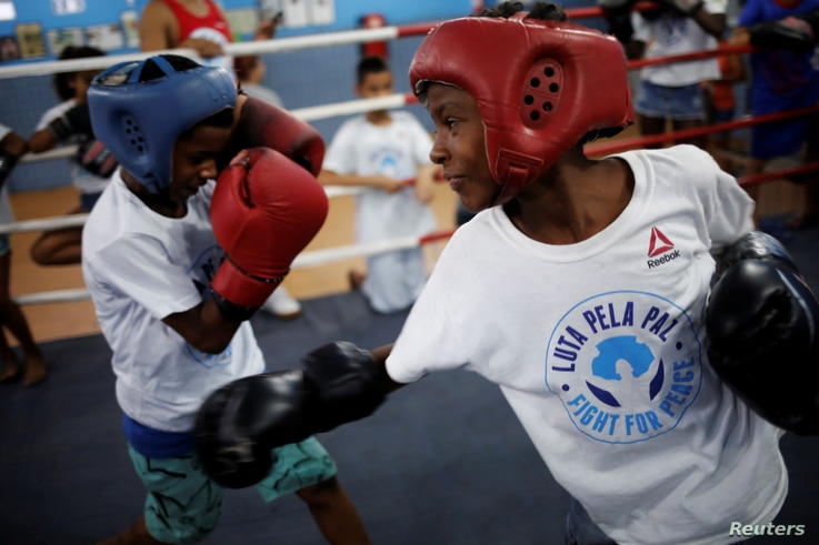 Children practice during an exercise session at a boxing school, in the Mare favela of Rio de Janeiro, Brazil, June 2, 2016.