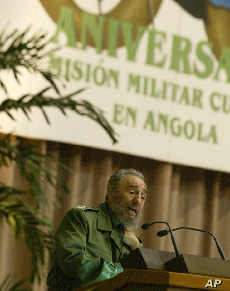 FILE - Fidel Castro, gestures while talking during an evening ceremony marking the 30th anniversary of Cuba's military mission in Angola, Dec. 2, 2005 in Havana, Cuba. Between 1975 and 1988, approximately 350,000 Cubans participated in the war of Ang...