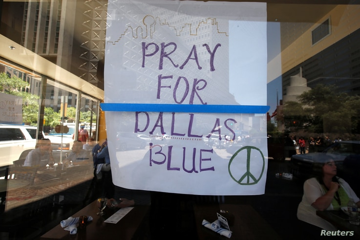 A restaurant posts a sign of support following the multiple police shooting in Dallas, Texas, July 8, 2016.
