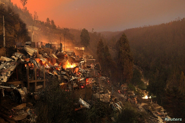Destroyed houses are seen at the location where a forest fire burned several neighborhoods in the hills in Valparaiso city, Chile, April 13, 2014.