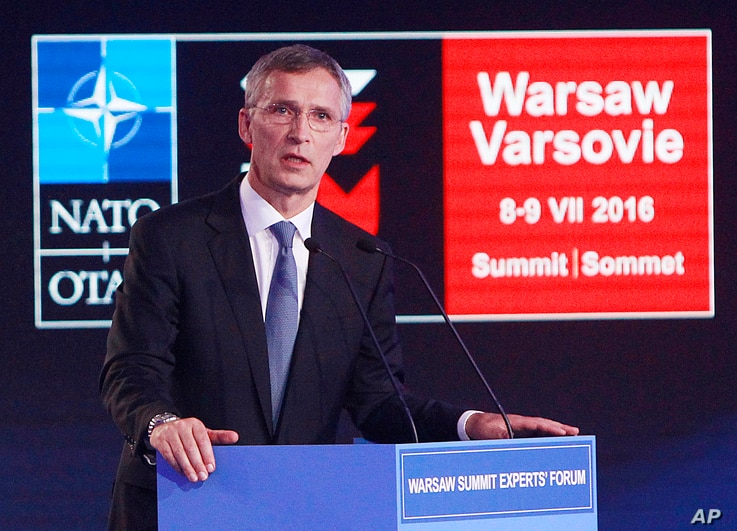 NATO Secretary General Jens Stoltenberg, right, speaks during the Warsaw Experts Forum prior to the official opening of the NATO summit in Warsaw, Poland, July 8, 2016.