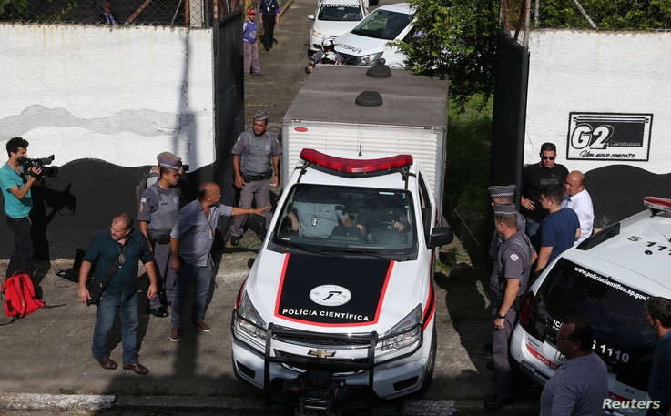 A vehicle of the forensic team leaves the Raul Brasil school after a shooting in Suzano, Sao Paulo state, Brazil, March 13, 2019.